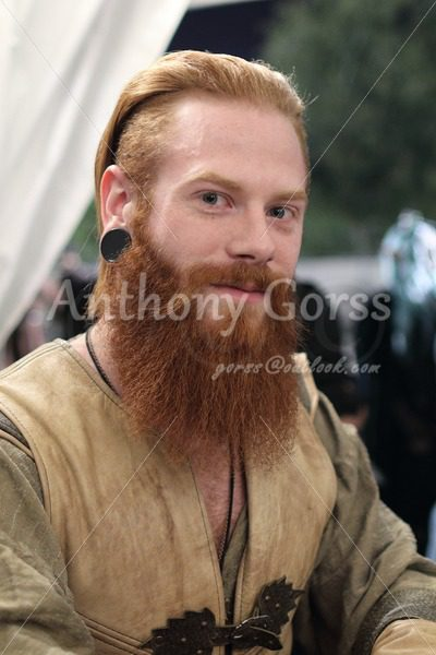 Vendor with red hair pulled back and long red beard